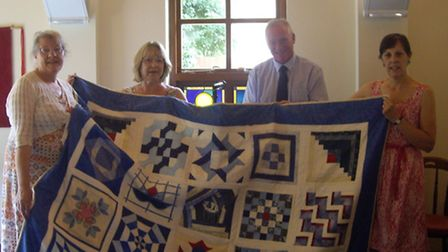 The South Cambs Quilters group worked on the organ cover and piano runner from last October to July