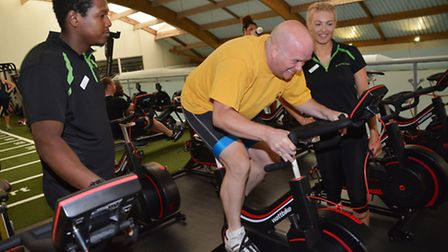 Sports reporter Neil Metcalfe with Wellbeing personal trainers Trevon Moora and Frances Slater. Pict