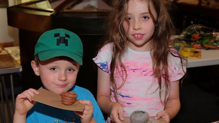 Daniel, 5 and Sophie Morgan, 8 with their clay pots at the Royston Museum Stone Age open day.