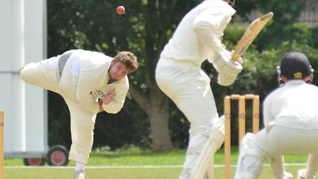Taylor West sends down a delivery for Ramsey during their defeat against Foxton. Picture: HELEN DRAK