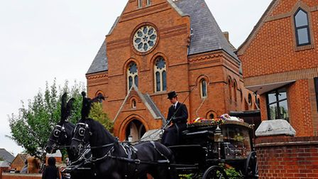 The horse drawn carriage leaves Dagnall Street Baptist Church carrying the coffin of Icilda Callum (