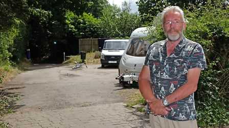 Cllr Chris Brazier next to the car park in Smallford where travellers have set up camp next to the A