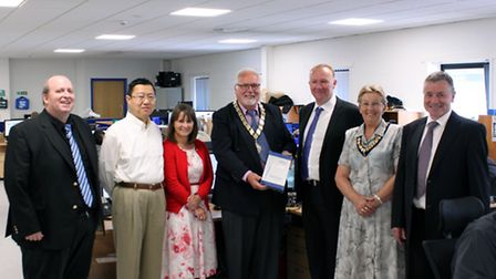 Mayor of St Neots Cllr Derek Giles (centre) with Pico Technology staff and mayors consort Sandie Gil