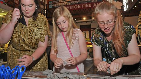 Royston museum curator Jenny Oxley, visitor Scarlett Hollamby, 8 and museum assistant Amy Judd make