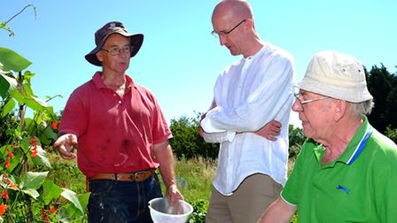 St Albans allotment owner Ken Kenwood chats to Cllr Simon Grover and committee member Bob Grover.