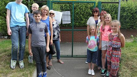 Parents and children next to the school gate in Royston.