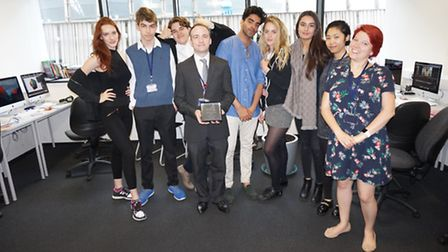 Centre - John Branney holding his award next to his students