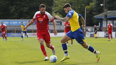 Louie Theophanous runs at the Whitehawk defence