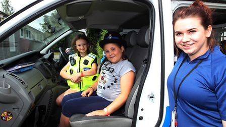Lauren Coningsby and Lucy Arber got to try on the uniform with PCSO Robyn Allen.