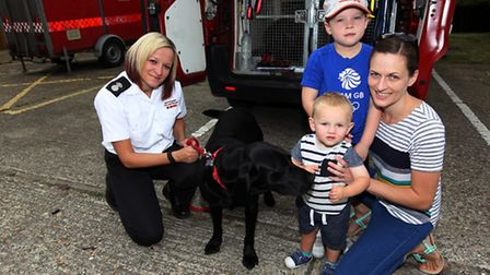 Nikki Harvey, with Reqs the fire dog, Laura Geldart, Mia and Callum at Royston Fire Station open day