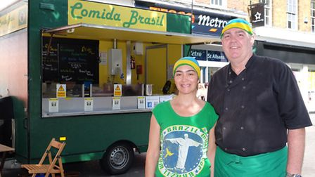 Comida Brasil owner Cristina Missias and husband Paul Fulton in front of their van.