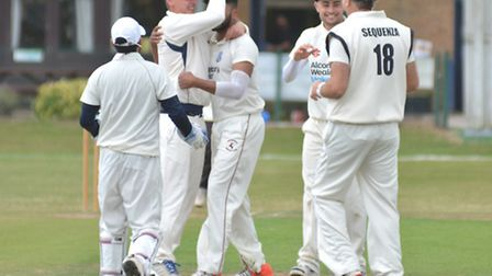 St Ives players celebrate a Nikhil Kumpukkal wicket against Huntingdon & District. Picture: HELEN DR