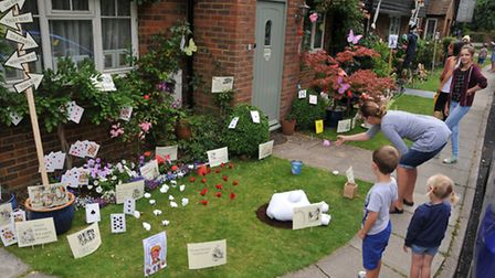 An Alice in Wonderland themed scarecrow display in the Flamstead scarecrow festival