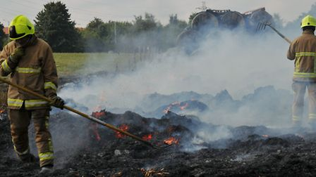 Firefighters attend a blaze at Willows Farm after a stack of hay bales were set alight.
