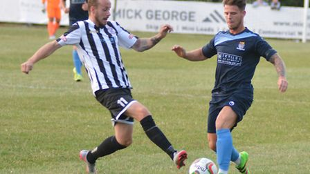 Josh Dawkin (left) fired a late winner to earn derby glory for St Ives Town. Picture: HELEN DRAKE