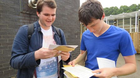 Sean Kerr and Matthew Bairstow from Bassingbourn Village College opening their GCSE results.