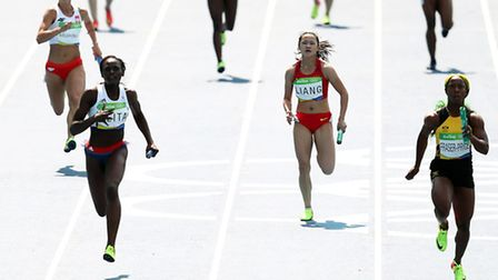 Great Britain's Daryll Neita (left during the women's 4x100m relay heats at the Olympic Stadium on t
