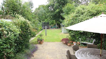 The rear garden includes a patio and a good-sized lawn