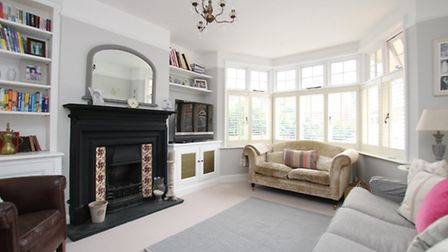The spacious living room has a feature fireplace