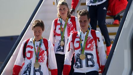 St Albans Hockey Club's Hannah Macleod wears her gold medal as she arrives back from Rio 2016 at Hea