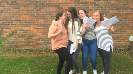 Girls celebrate their GCSE results at Freman College.