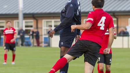 Dubi Ogbonna in action for St Neots against King's Lynn last Tuesday. Picture: CLAIRE HOWES