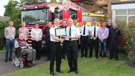 David Kilner recieves a certificate from Chief Fire Officer Chris Strickland.