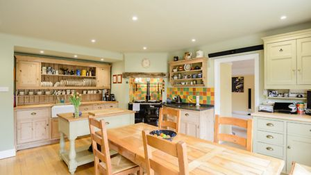The farmhouse-style kitchen/breakfast room has an Aga as its centrepiece