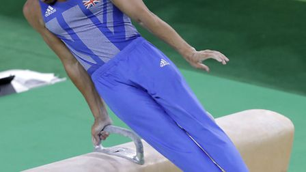 Britain's Louis Smith performs on the pommel horse during the artistic gymnastics men's qualificatio