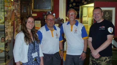 Museum assistant Jenny Benton with Steve Kilford and Brian Pepper from Royston Bowls Club and Glen S