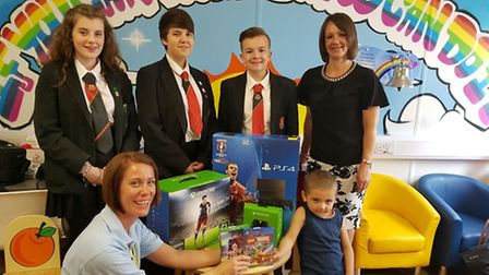 The consoles were taken to Lister Hospital by, from back left,Lauren O'Neil, Caitlin Waller, Chad Ma