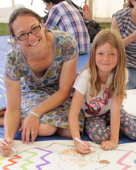 Georgina Campbell assists her daughter, Imogen to construct her own kite at the kite workshop. PICTU