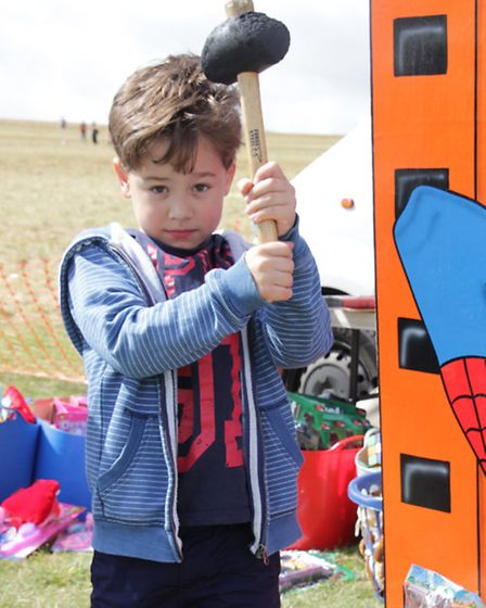 Eight-year-old Ben Spenceley of Foxton tries his luck at the Test Your Strength stall. PICTURE: Cliv