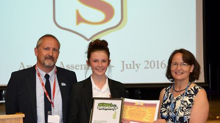 Elouise Wathen was presented with a gold award for achievement by Mark Russell from Macmillan Cancer