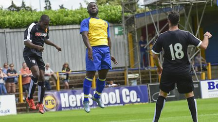 Junior Morias connects with a header. Picture: BOB WALKLEY