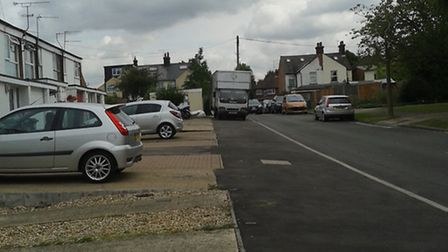 Vehicles have been driving on the footpath (left) as they believe that it is part of the main road.