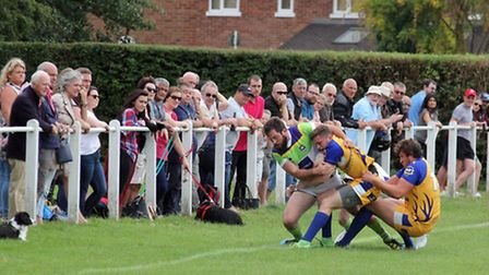 Joe Baker pulls a Stags player into touch. Picture: DARRYL BROWN