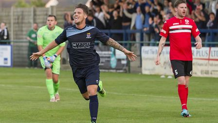 Declan Rogers, celebrating here after striking for St Neots Town against King's Lynn last Tuesday, i