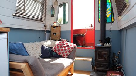 The boat has a kitchen with oven and fridge