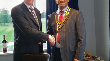 New president Vijay Patel is welcomed in by former leader Mick Marks