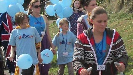 Forty-five people walked through St Albans city centre to raise more than 2,000 for research into a
