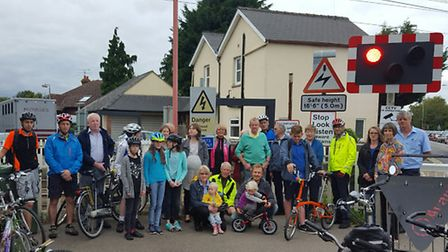 Protesters gathered at the level crossing in Foxton on Tuesday.