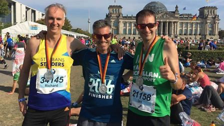 Richard Olney, left, Stephen Elkan, middle, and Ian Hirth, right, after completing the Berlin Marath