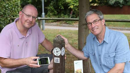 Highfield Park Trust trustee Andy Grant and park manager Richard Bull with one of the interactive tr