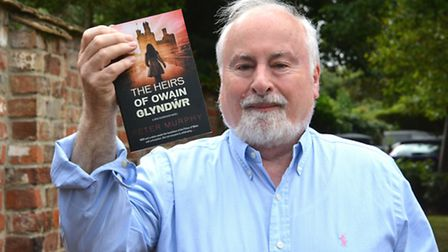 Local author Peter Murphy, with his book