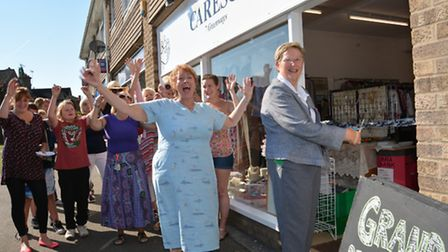 Grand re-opening of charity shop CARESCO, Sawtry, ribbon cutting by Chairman of the Parish Council D