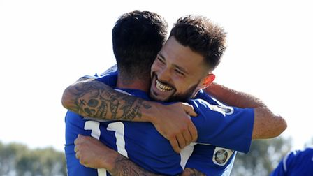 Louie Theophanous is congratulated by Matt Ball after he slotted home the Saints third of the aftern