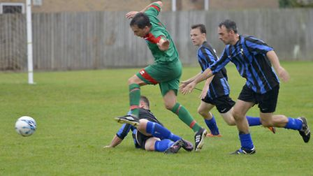 Action from Huntingdon United's victory against St Ives Rangers. Picture: DUNCAN LAMONT