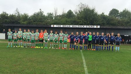 Huntingdon Rowdies and St Ives Rangers Girls are pictured ahead of their historic clash in the openi