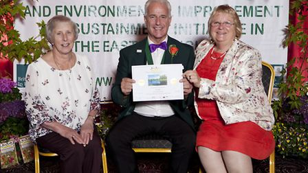 Jeff Taylor: Moreen Wells and Marney Hall receiving the award.